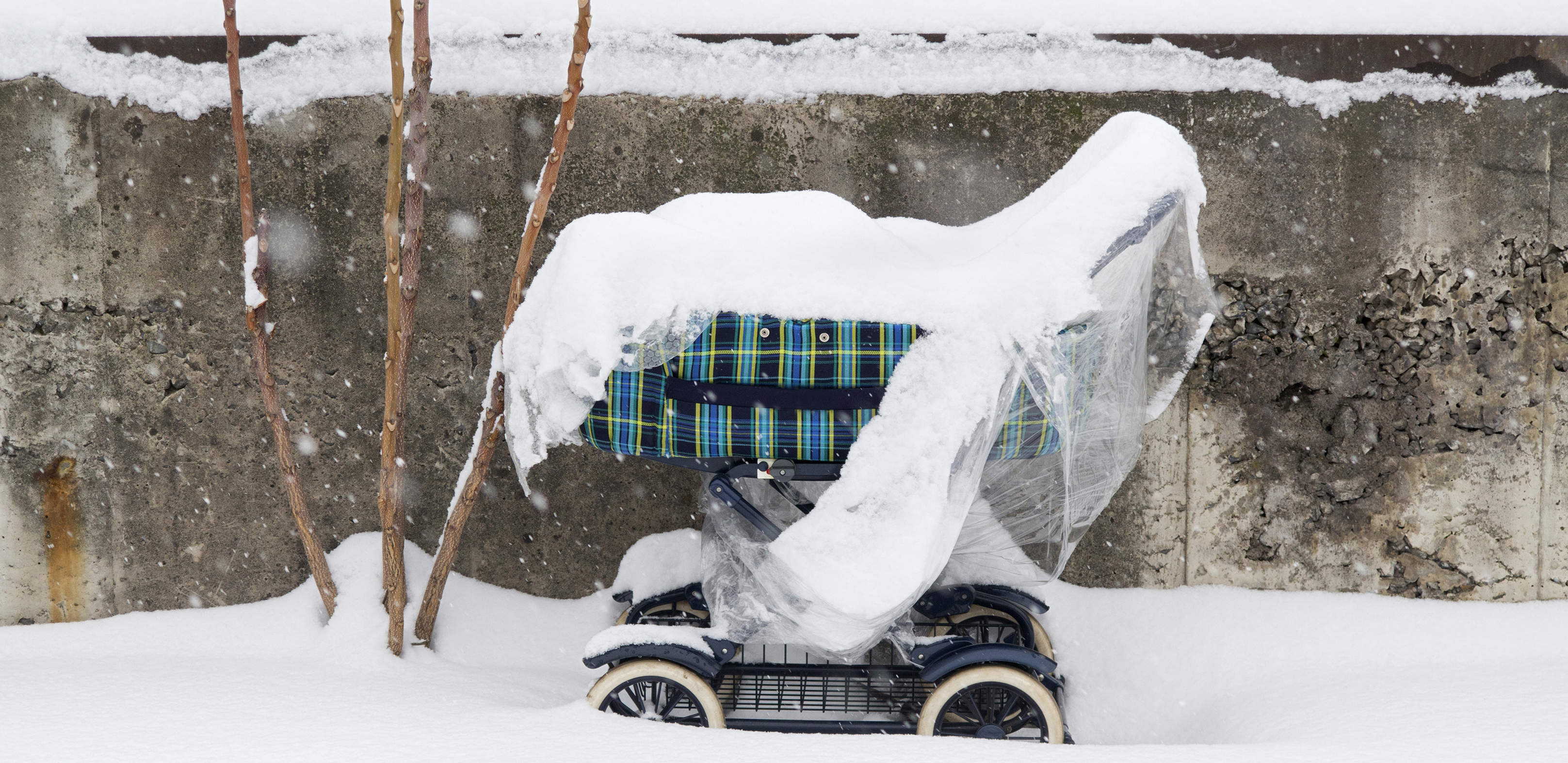 Weatherproof Baby - imafe of the snowy baby carriage